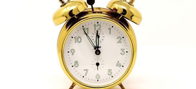 A gold alarm clock.