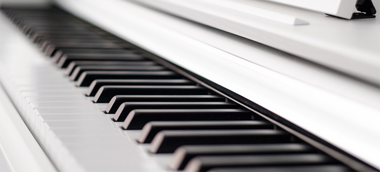 A white, clean and nice looking piano