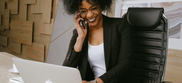 Woman in black blazer sitting on black office chair