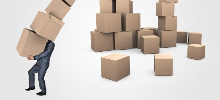 reuse moving boxes - a man moving box