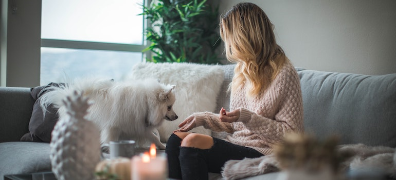 A girl and a dog on the couch