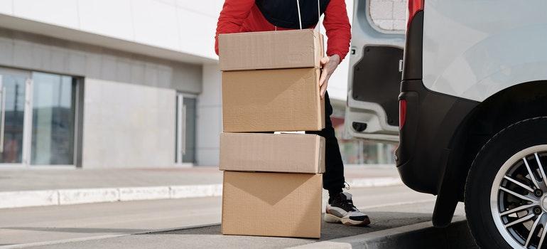 Guy packing boxes in the van